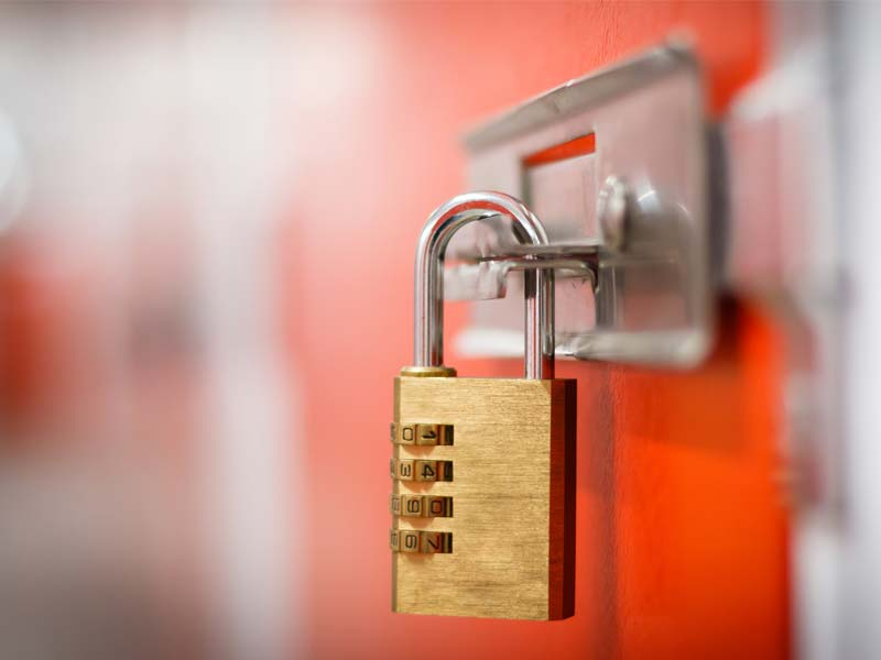 Close-up of a padlock on a storage container door